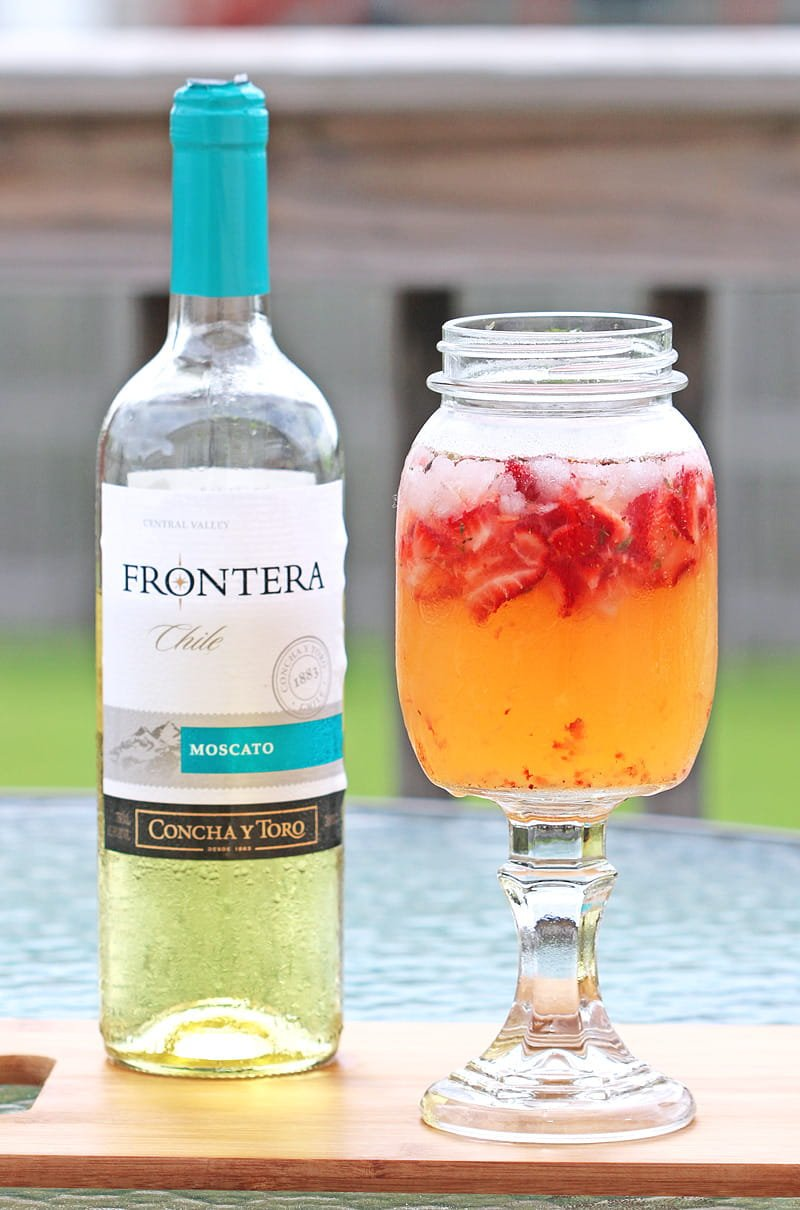 Easy, delicious wine cocktail made with honey, strawberries, lemon juice & Moscato wine. This wine cocktail is perfect for summer gatherings.
