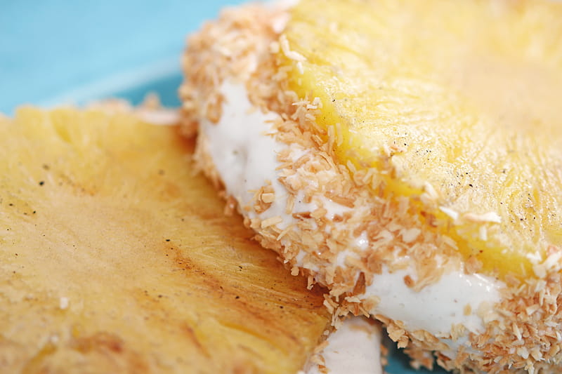 Tropical Ice Cream Sandwich made with grilled pineapple, vanilla ice cream and toasted coconut. Simple, family-friendly and delicious!