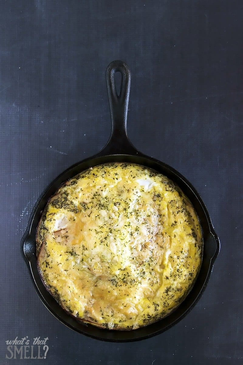 Turkey & Cheese Frittata recipe in a cast iron pan on a black background