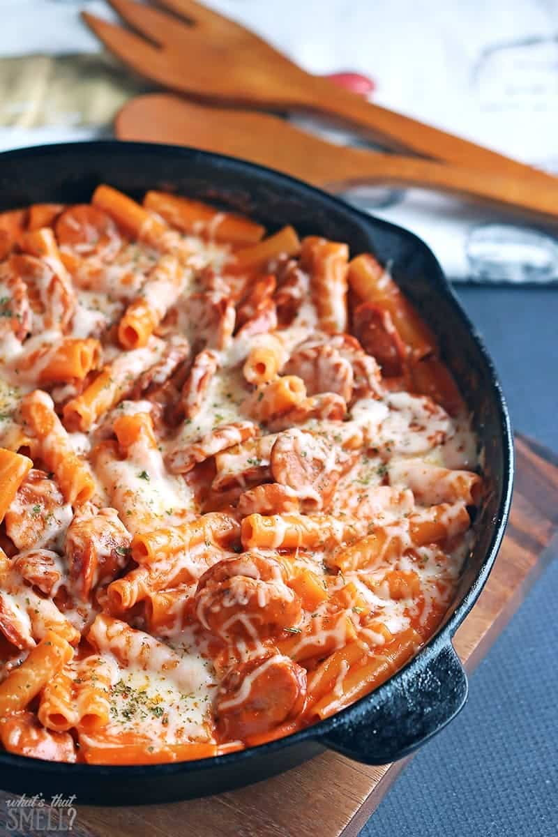 """Cheesy Pasta with Cajun Andouille Sausage Recipe - this quick and easy recipe cooks in a single skillet and will leave everyone begging for """"more please""""!"""