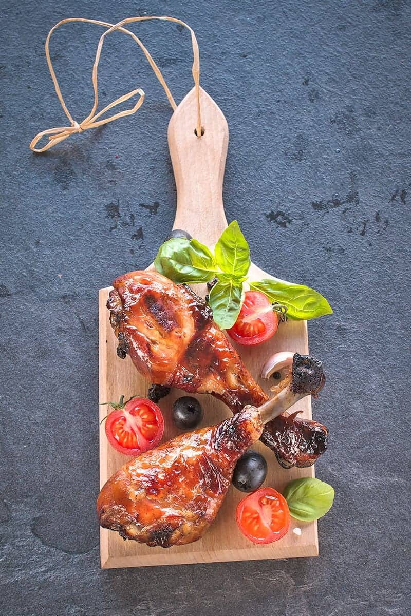 low carb Chicken legs and veggies on a wooden board