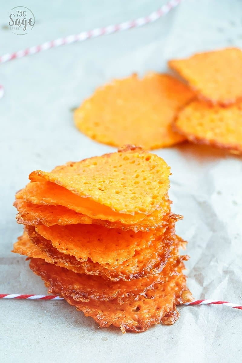 Low carb garlic cheddar cheese crisps are keto-friendly and are super easy to make & will satisfy your cravings for chips and salty snacks. Eat alone or with a low carb dip! So good!