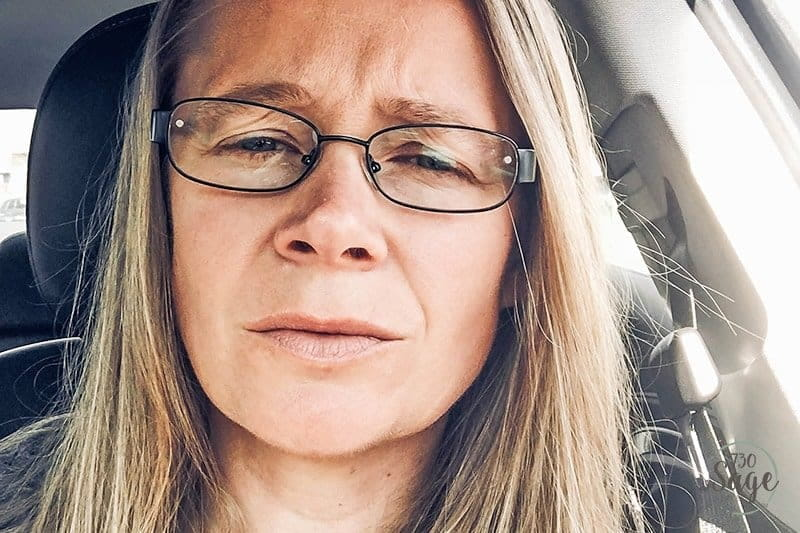 woman squinting with bifocals on in car needs Solar Shield Fits Over Sunglasses
