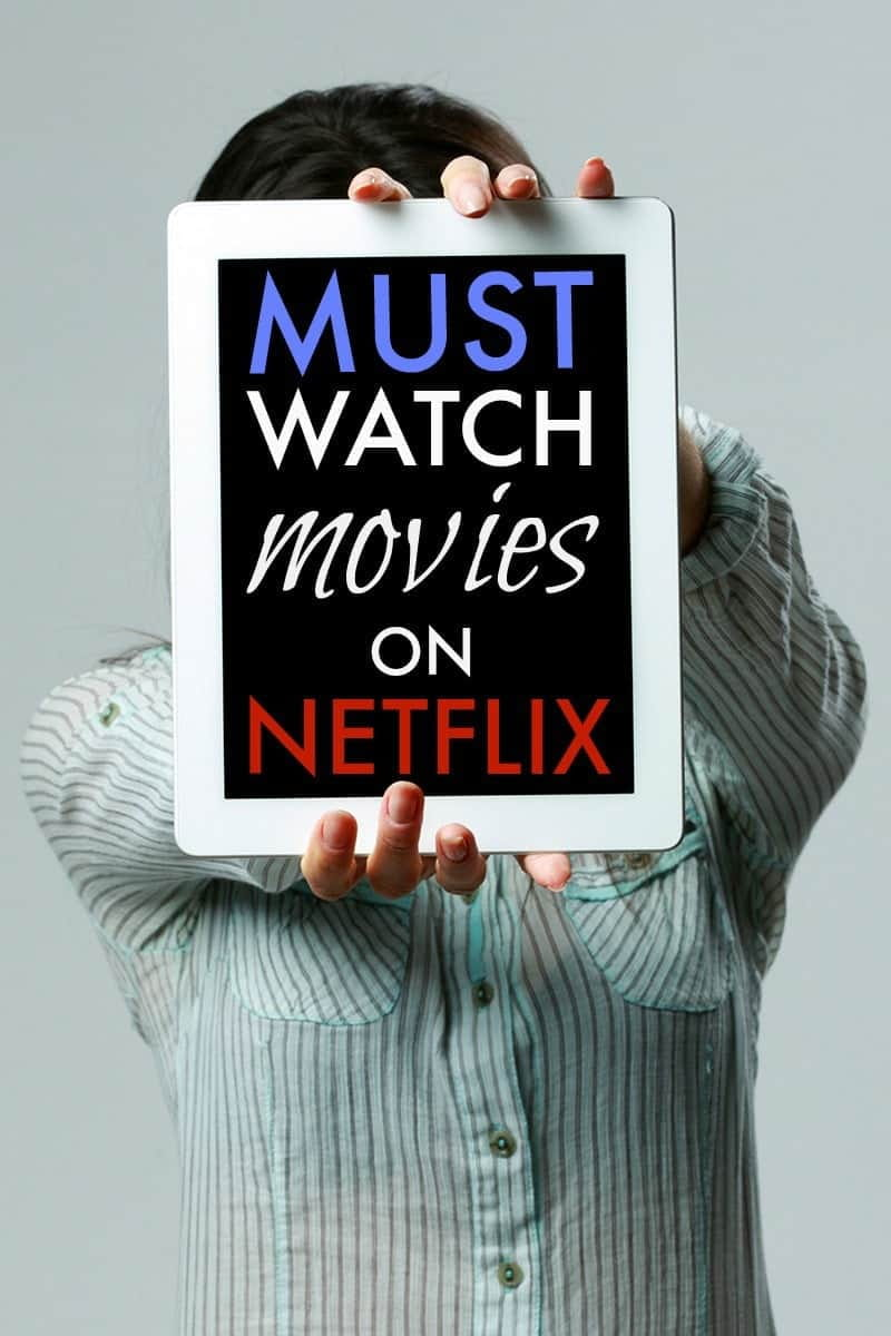 A woman holding a chalkboard advertising Good Netflix Movies - Good Movies to Watch on Netflix