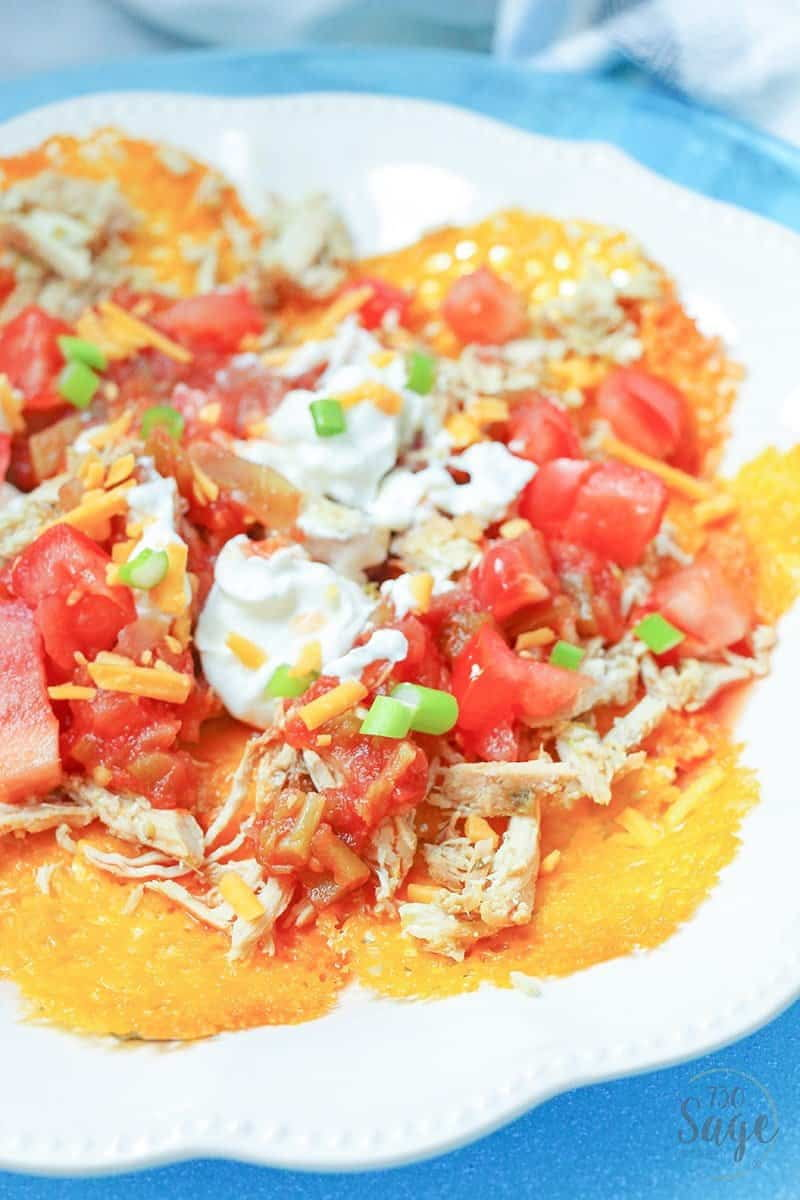 keto nachos - low carb nachos close up with sour cream on a blue plate