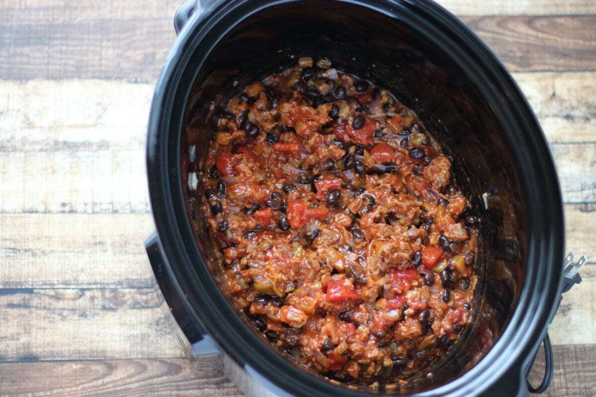 Vegetarian beef, black beans tomatoes, enchilada sauce in crockpot