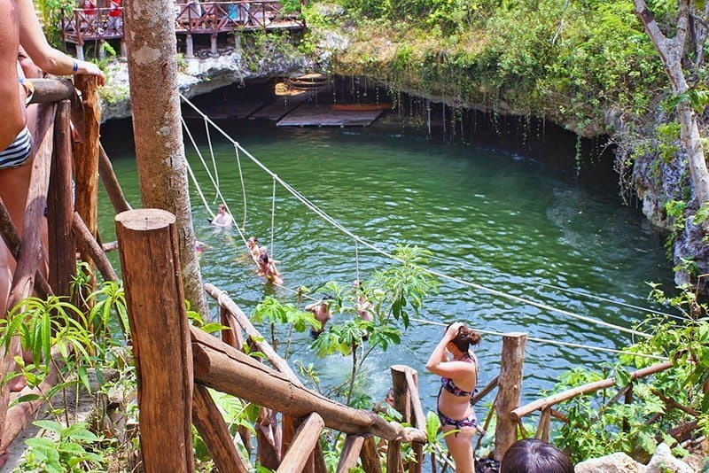 green water surrounded by lush green Cancun jungle - travel safety