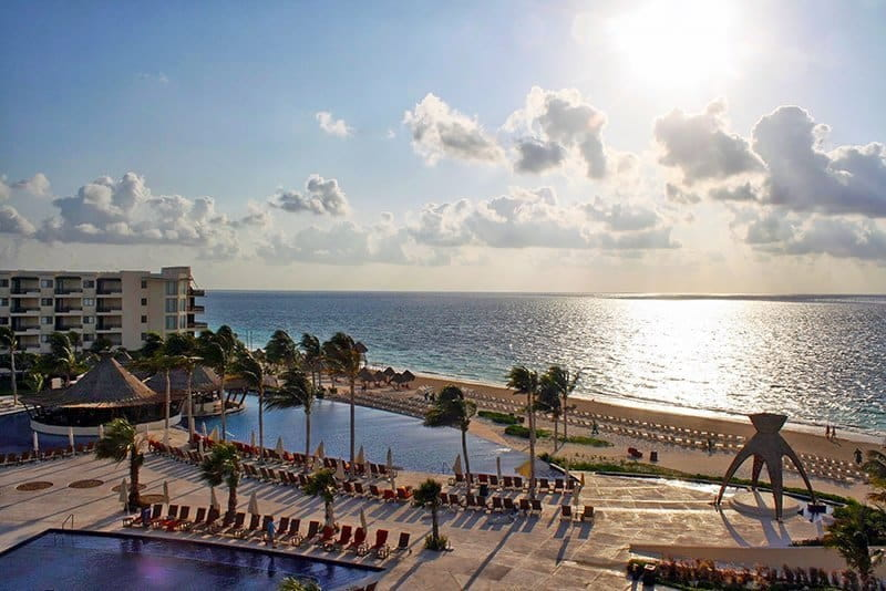 sunset view of resort grounds and beach from above in Cancun