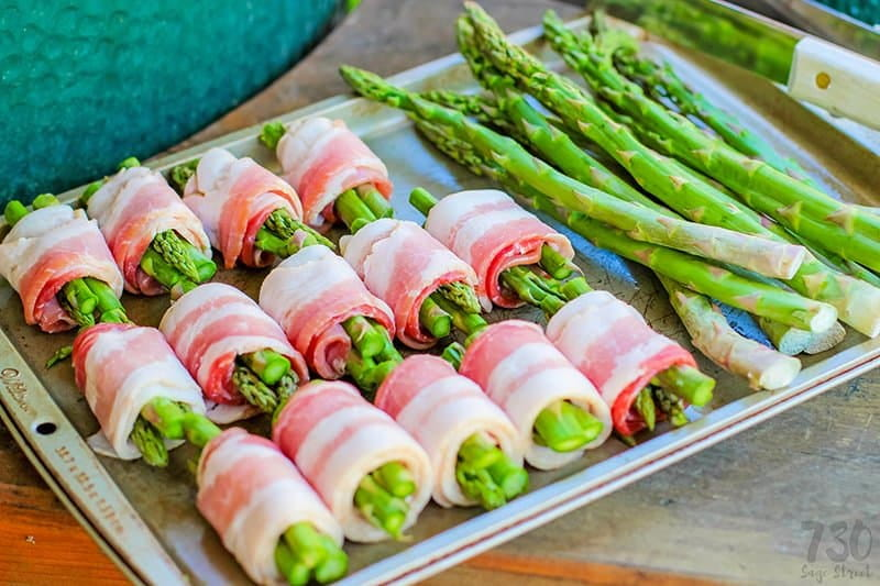 bacon wrapped asparagus on a cookie sheet
