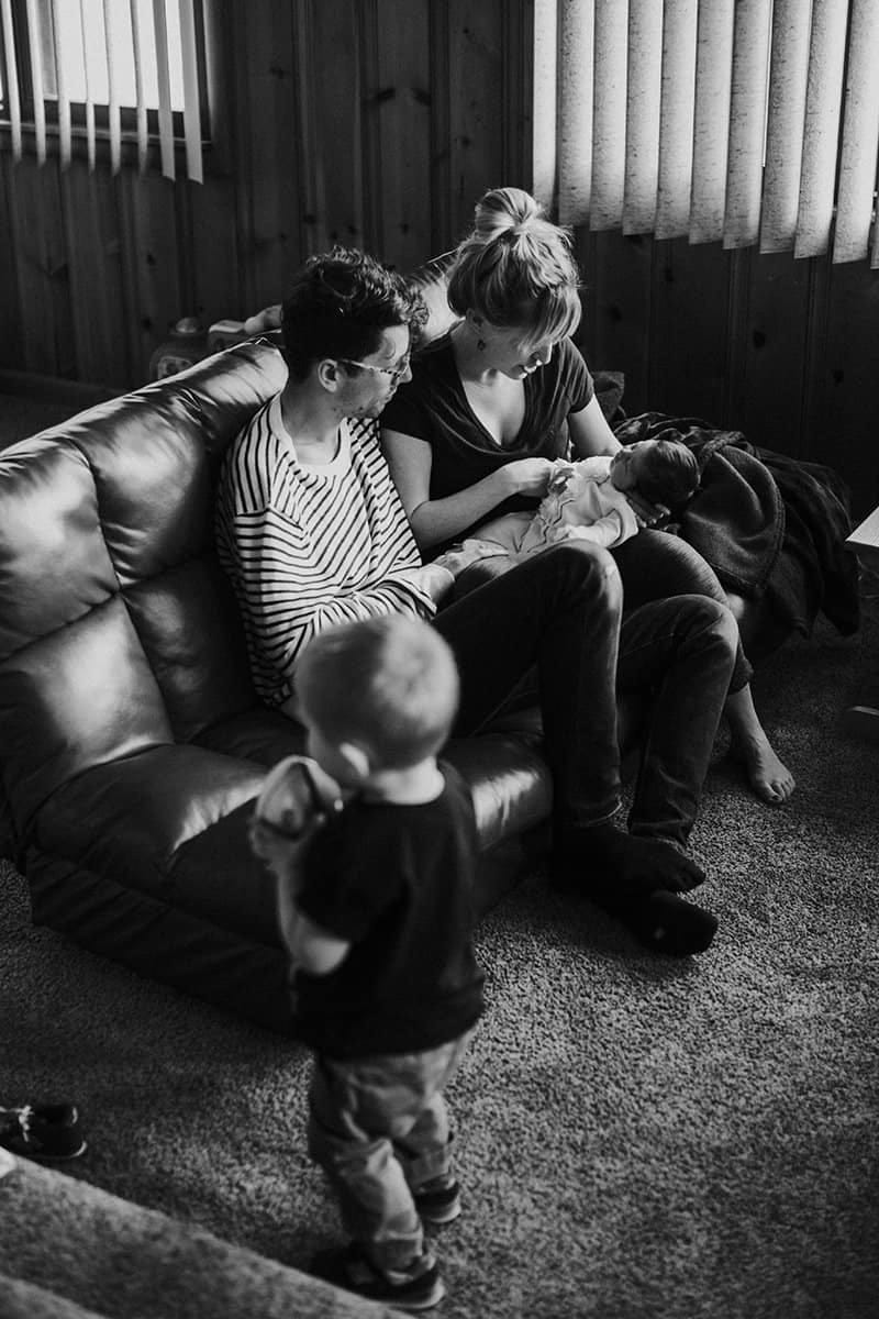 black and white photo of a family in their living room