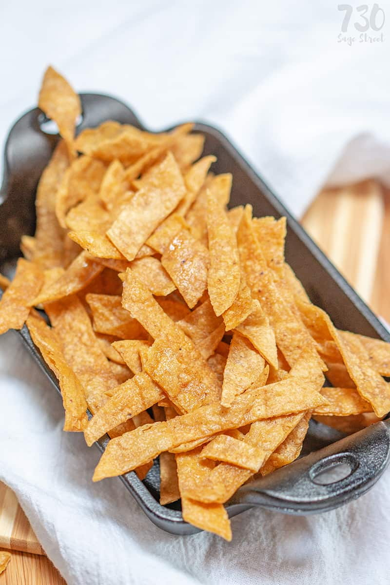 baked tortilla strips in a cast iron pan