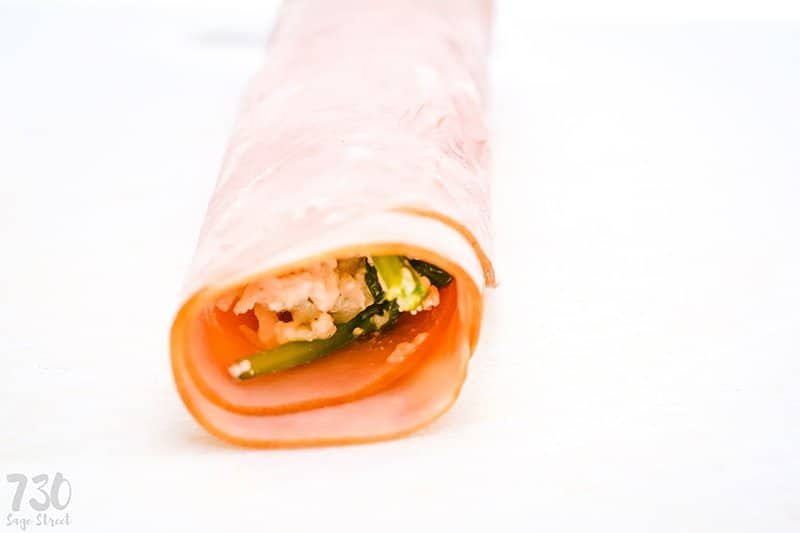 ham roll up on a white background