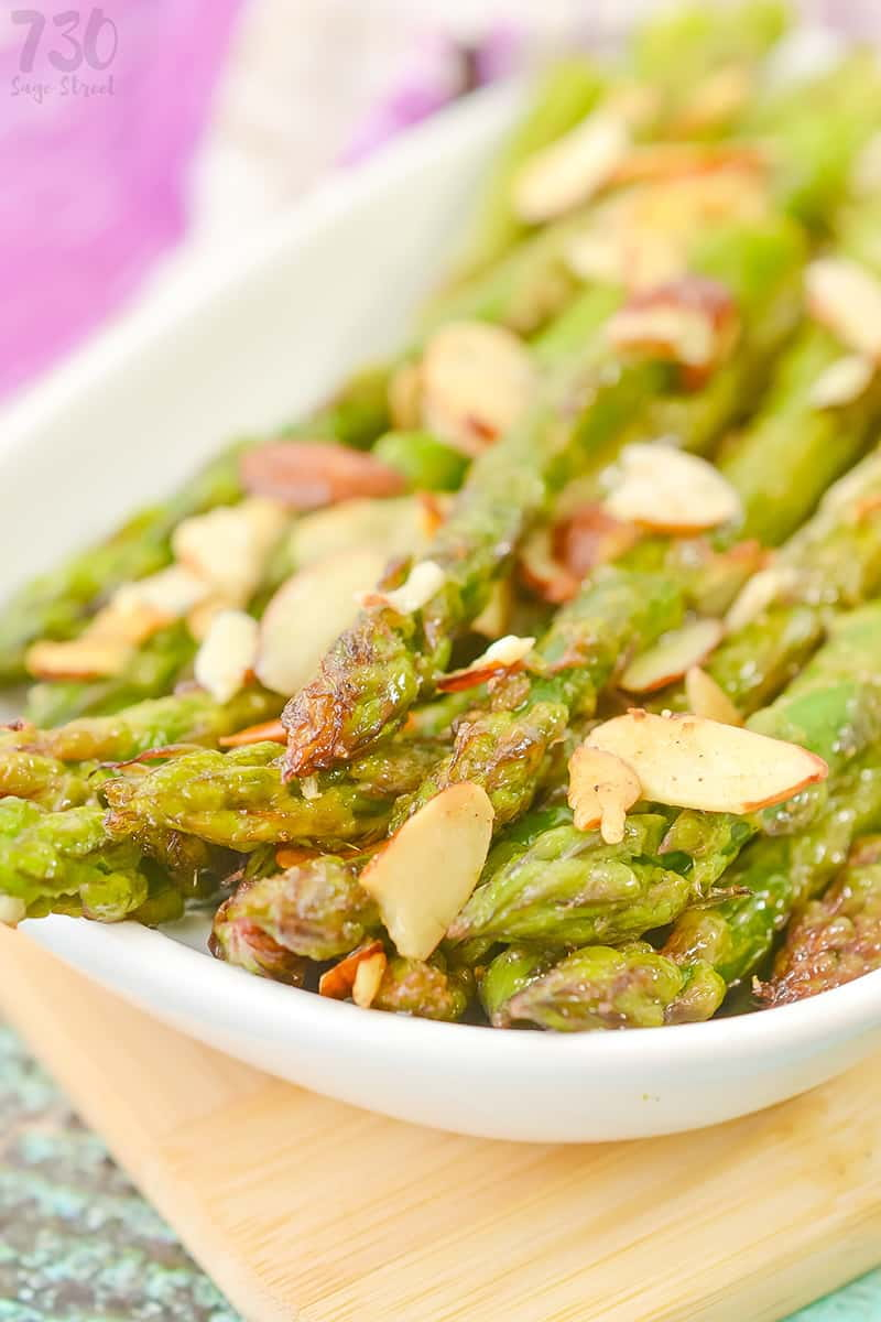 asparagus recipe with almonds on a white plate