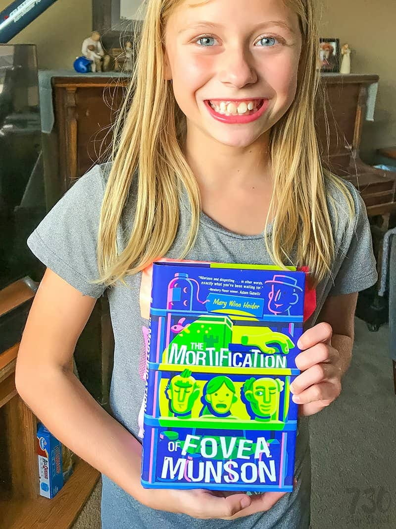 girl holding a Halloween book