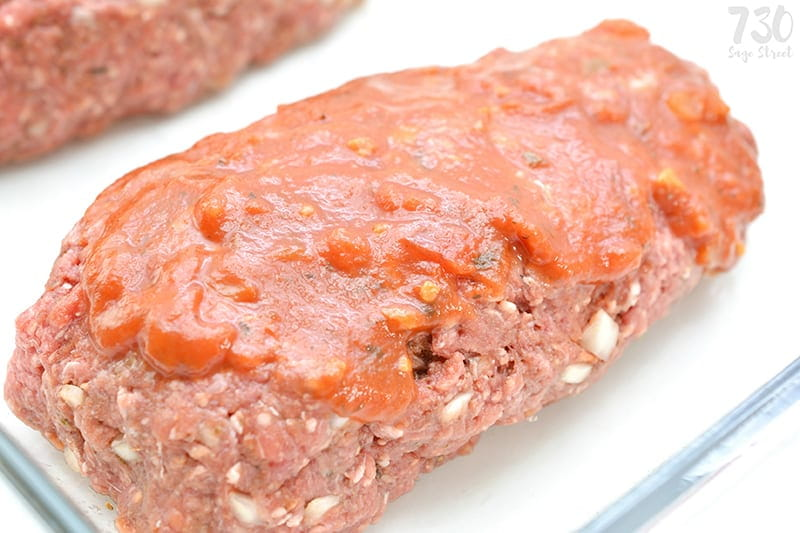 raw meatloaf on a white plate