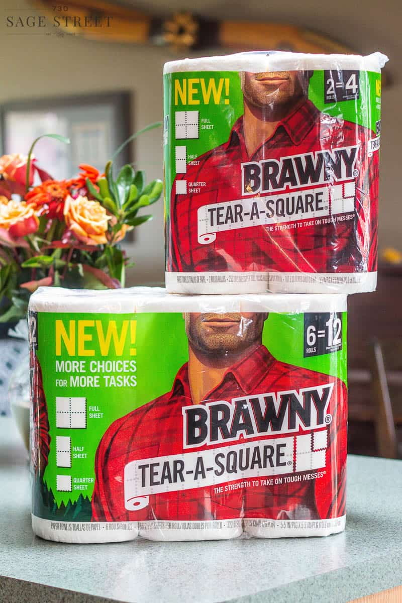 two packages of Brawny Tear-A-Square paper towels on a kitchen counter