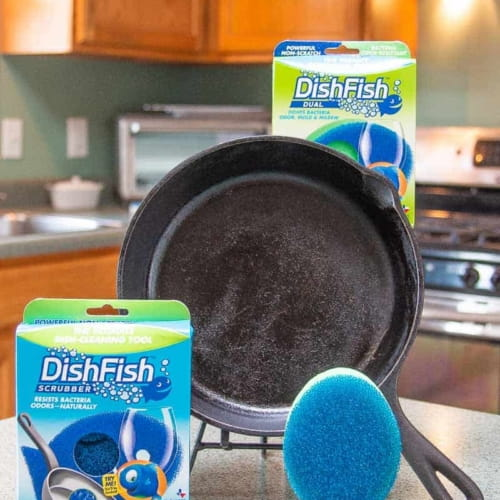 DishFish sponges and packaging on a green counter