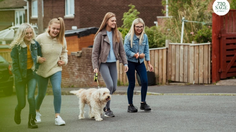 teenagers walking their dog, helping with chores