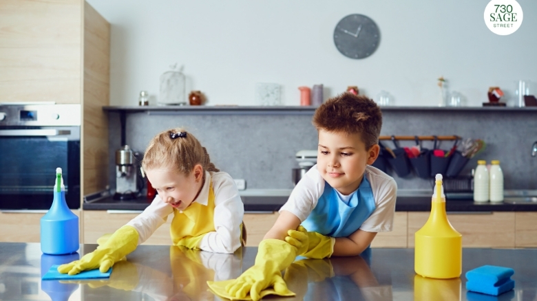 two school aged children helping with chores, cleaning kitchen table