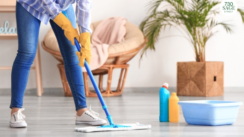 mother mopping floor with microfiber mop with homemade all purpose floor cleaner
