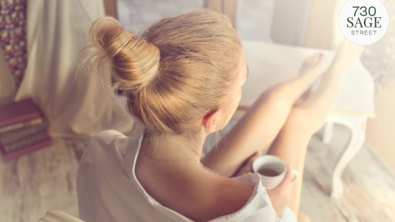 Woman pampering herself with a cup of coffee.