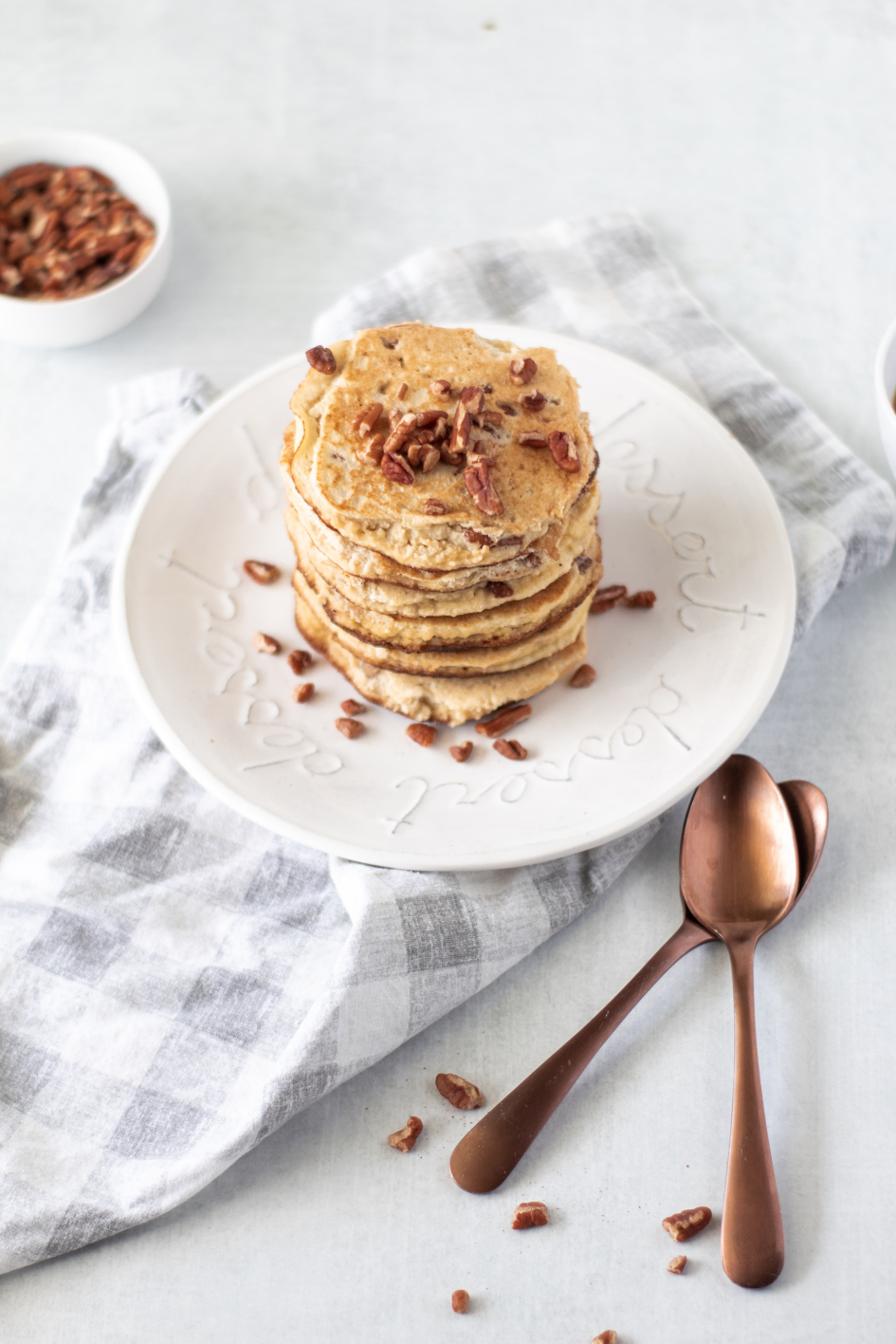Keto Pancakes on white plate topped with pecans